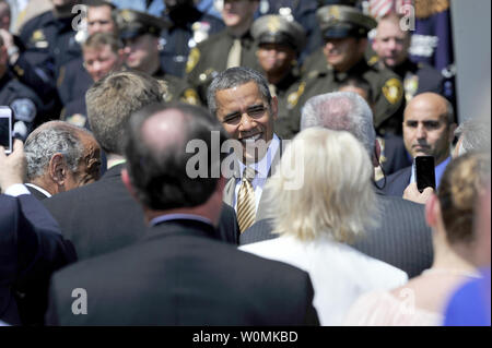 President Barack Obama greets some of the dignitaries after he and U.S. Vice President Joe Biden honored the 2012 National Association of Police Organizations (NAPO) TOP COPS award winners during a ceremony in the Rose Garden of the White House in Washington, D.C. on May 12, 2012.  UPI/Ron Sachs/Poo - Stock Photo