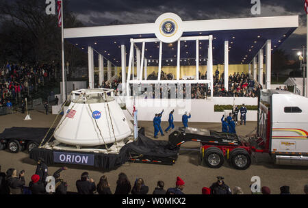 The Orion space capsule along with NASA Astronauts Lee Morin, Alvin Drew, Kjell Lindgren, Serena Aunon, Kate Rubins, and Mike Massimino pass the Presidential viewing stand and President Barack Obama during the inaugural parade honoring Obama on  January 21, 2013, in Washington, DC. President Obama was sworn-in for a second term as the 44th President of the United States.   UPI/Bill Ingalls/NASA - Stock Photo