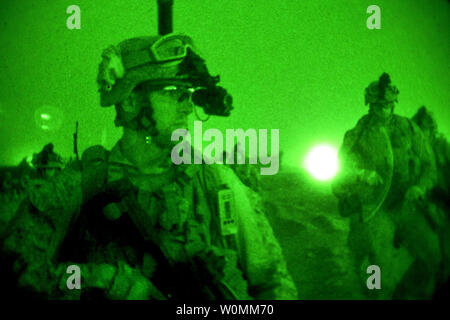 As seen through a night-vision device, U.S. Marines conduct mission rehearsals on Camp Leatherneck in Afghanistan's Helmand province, July 10, 2013. The Marines, assigned to Golf Company, 2nd Battalion, 8th Marine Regiment, trained to maintain operational readiness and efficiency. .UPI/Cpl. Alejandro Pena/DoD - Stock Photo