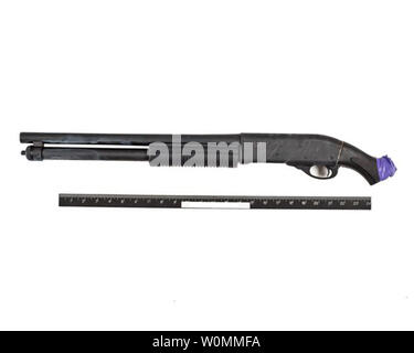 A FBI released still photo on September 25, 2013 shows the Remington 870 shotgun with sawed-off barrel and stock used by Aaron Alexis to kill 12 people before he was killed by police at the Washington Navy Yard on September 16, 2013 in Washington, DC.   Etchings on the left side of the shotgun read 'Better off this way!' and 'My ELF weapon'.  UPI - Stock Photo