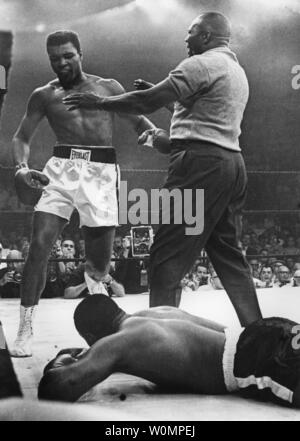 Boxing great Muhammad Ali died at the age of 74 in Phoenix, Arizona on Saturday, June 4, 2016.  He is shown being restrained by referee Joe Walcott after he knocked out  Sonny Liston in the first round of their title fight on May 25, 1965 in Lewiston, Maine.  He was known as Cassius Clay at the time before changing his name.  UPI - Stock Photo