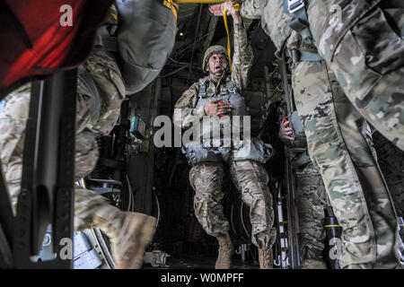 U.S. Army Soldiers exit a C-130J Super Hercules assigned to the 37th Airlift Squadron, Ramstein Air Base, Germany, during an airborne operation over the Normandy region of France, June 5, 2016. American, French and German service members participated in the airborne operation in commemoration of the 72nd anniversary of D-Day. Photo by Staff Sgt. Timothy Moore/U.S. Air Force/UPI - Stock Photo