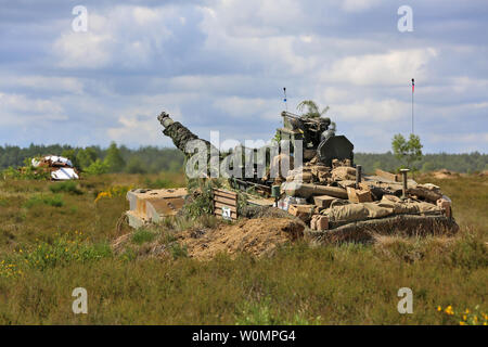 U.S. Soldiers assigned to 2nd Battalion, 7th Infantry Division, 1st Armored Brigade Combat Team, maneuver the M1A2 System Enhancement Package (SEP) v2 Abrams main battle tank during Operation Anakonda in the Drawsko Pomorskie Training Area (DPTA) near Olezno, Poland, on June 9, 2016. Exercise Anakonda 2016 is a Polish-led multinational exercise, taking place in Poland from June 7-17. This exercise involves more than 25,000 participants form more than 20 nations. Photo by Sgt. Ashley Marble/U.S. Army/UPI - Stock Photo