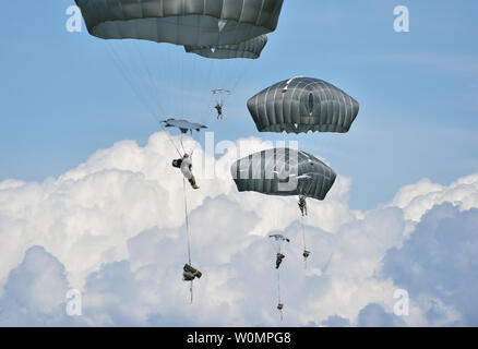 Paratroopers assigned to the 4th Infantry Brigade Combat Team (Airborne), 25th Infantry Division, U.S. Army Alaska, execute an airborne proficiency operation at Joint Base Elmendorf-Richardson, Alaska, June 9, 2016, during Exercise Arctic Aurora. Arctic Aurora is a yearly bilateral training exercise involving elements of the Spartan Brigade and the Japan Ground Self-Defense Force, which focuses on strengthening ties between the two by executing combined small unit airborne proficiency operations and basic small arms marksmanship. Photo by Justin Connaher/U.S. Air Force/UPI - Stock Photo
