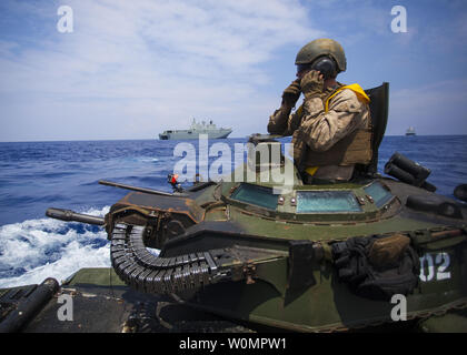 Cpl. Ryan Dills communicates with other assault amphibious vehicles while traveling from amphibious assault ship USS San Diego to Royal Australian Navy Canberra class amphibious ship HMAS Canberra (L02) in the Pacific Ocean, on July, 18 2016. The Marines are participating in Rim of the Pacific (RIMPAC) 2016, a multinational military exercise, from June 29 to August 4 in and around the Hawaiian Islands. Photo by Christopher Giannetti/U.S. Marine Corps/UPI