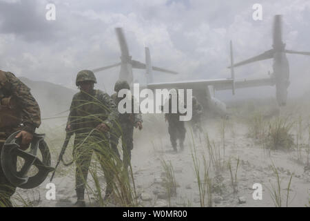 U.S. Marines assigned to Lima Company, 3rd Battalion, 3rd Marine Regiment and Philippine Marines exit an MV-22B Osprey at the Armed Forces of the Philippines Crow Valley training facility in support of Air Assault Support Exercise 16.2, August 6, 2016. The recurrence of the Air Assault Support Exercise each year demonstrates the U.S. and Republic of the Philippines' commitment to mutual security and our long-time partnership.  Photo by Carl King/U.S. Marine Corps/UPI - Stock Photo