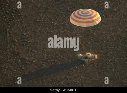 The Soyuz TMA-20M spacecraft is seen as it lands with Expedition 48 crew members NASA astronaut Jeff Williams, Russian cosmonauts Alexey Ovchinin, and Oleg Skripochka of Roscosmos near the town of Zhezkazgan, Kazakhstan on Wednesday, Sept. 7, 2016(Kazakh time). Williams, Ovchinin, and Skripochka are returning after 172 days in space where they served as members of the Expedition 47 and 48 crews onboard the International Space Station.   NASA Photo by Bill Ingalls/UPI - Stock Photo