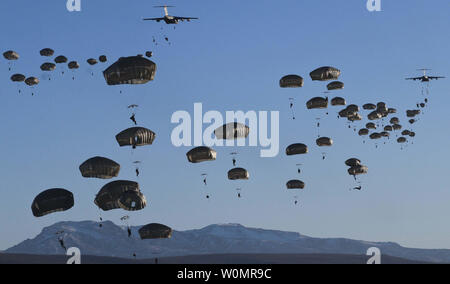 Paratroopers from 3rd Battalion, 509th Parachute Infantry Regiment, 4th Infantry Brigade Combat Team (Airborne), 25th Infantry Division jump on Donnelly Drop Zone from C-17 Globemaster aircraft during a joint forcible entry exercise at Fort Greely, Alaska, on October 12, 2016. The operation was part of Exercise Spartan Cerberus, a 4/25 operation focusing on joint airborne operations. Photo by Donald Williams/U.S. Army/UPI - Stock Photo