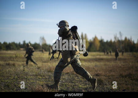 A U.S. Marine with Golf Company, 2nd Battalion, 8th Marine Regiment, assaults his target during a live-fire shoot, on October 18, 2016, as part of Exercise Silver Arrow 2016 at Adazi Military Base, Latvia. The 2/8 Marines are currently deployed in Europe as part of the Black Sea Rotational Force and are participating in this year's Silver Arrow along with eight other North Atlantic Treaty Organization (NATO) allies. Photo by Erik Estrada/U.S. Marine Corps/UPI - Stock Photo