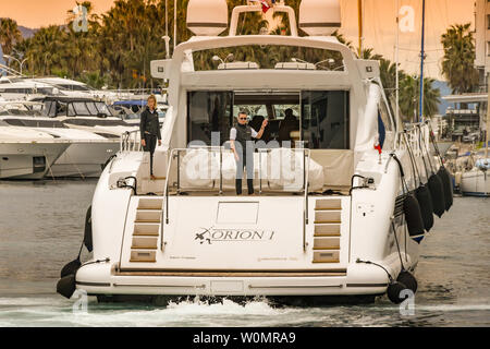 CANNES, FRANCE - APRIL 2019: Luxury motor yacht Orion I reversing into its harbour berth in Cannes. - Stock Photo