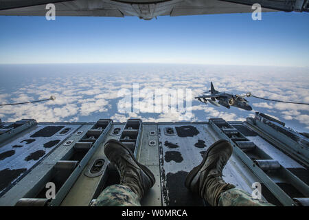 A U.S. Marine Corps AV-8B Harrier assigned to Marine Attack Squadron (VMA) 223, conducts an aerial refuel near Marine Corps Air Station Cherry Point, NC, November 15, 2016. Marine Aerial Refueler Transport Squadron 252 participated in an aerial refueling exercise with VMA-223, Marine Tactical Electronic Warfare Squadron 3, and Marine Medium Tiltrotor Squadron 365 to maintain interservice operability. Photo by Lance Cpl. Anthony J. Brosilow/U.S. Marine Corps/UPI - Stock Photo
