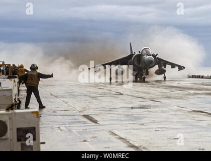 An AV-8B Harrier from the 22nd Marine Expeditionary Unit (22nd MEU) launches off the flight deck of the amphibious assault ship USS Wasp (LHD 1) on December 19, 2016. Wasp is deployed as part of the Wasp Amphibious Ready Group, which is offloading the 22nd MEU after completing a six-month deployment to the U.S. 5th and 6th Fleet areas of operations. Photo by Levingston Lewis/U.S. Navy/UPI - Stock Photo