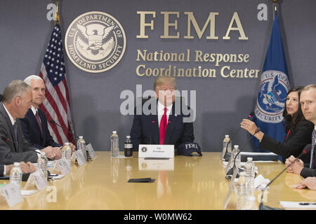 U.S President Donald J. Trump (C) visits the Federal Emergency Management Agency (FEMA) headquarters in Washington, DC, on August 4, 2017. Trump visited FEMA headquarters to receive a briefing on the hurricane season. Also in the picture is US Vice President Mike Pence (2-L), US Interior Secretary Ryan Zinke (L) and  Acting Director of the Department of Homeland Security Elaine Duke (2-R)   Photo by Michael Reynolds/UPI - Stock Photo
