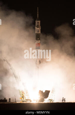 The Soyuz MS-08 rocket is launched with Expedition 55 Soyuz Commander Oleg Artemyev of Roscosmos and flight engineers Ricky Arnold and Drew Feustel of NASA, on March 21, 2018, at the Baikonur Cosmodrome in Kazakhstan. Artemyev, Arnold, and Feustel will spend the next five months living and working aboard the International Space Station. NASA Photo by Joel Kowsky/UPI - Stock Photo