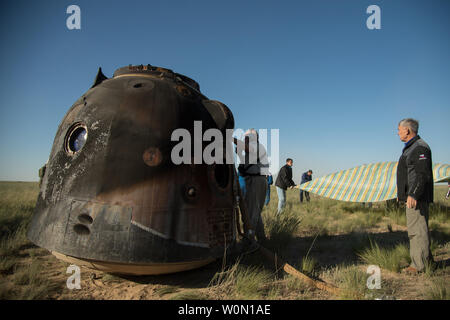 Russian Search and Rescue teams arrive at the Soyuz MS-07 spacecraft shortly after it landed with Expedition 55 crew members Anton Shkaplerov of Roscosmos, Scott Tingle of NASA, and Norishige Kanai of the Japan Aerospace Exploration Agency (JAXA) near the town of Zhezkazgan, Kazakhstan on June 3, 2018. Shkaplerov, Tingle, and Kanai are returning after 168 days in space where they served as members of the Expedition 54 and 55 crews onboard the International Space Station. NASA Photo by Bill Ingalls/UPI - Stock Photo