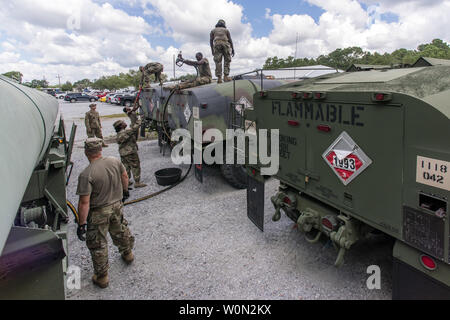 South Carolina National Guard Soldiers from the 118th Forward Support Company transfer bulk diesel fuel into M987 HEMTT fuel tanker trucks for distribution in preparation to support partnered civilian agencies and safeguard the citizens of the state in advance of Hurricane Florence, in North Charleston, South Carolina, on September 10, 2018. Approximately 800 Soldiers and Airmen have been mobilized to prepare, respond and participate in recovery efforts as forecasters project Hurricane Florence will increase in strength with potential to be a Category 4 storm and a projected path to make landf - Stock Photo