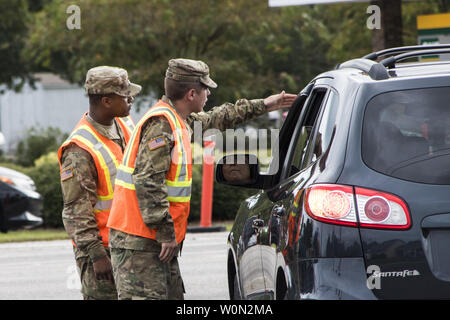 South Carolina National Guard Soldiers from B Battery, 1st of the 178th Field Artillery work with South Carolina Highway Patrol officers at a traffic control point in Conway, S.C. during the lane reversal of Highway 501 in support of the Myrtle Beach area evacuation to safeguard the citizens of the state in advance of Hurricane Florence, on September 11, 2018. Approximately 2,000 Soldiers and Airmen have been mobilized to prepare, respond and participate in recovery efforts for Hurricane Florence, a Category 4 storm, with a projected path to make landfall along the Carolinas and east coast. Ph - Stock Photo