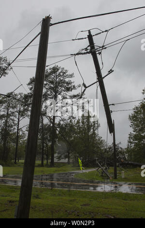 Utility poles collapse during Hurricane Florence, on Marine Corps Base Camp Lejeune, on September 15, 2018. Hurricane Florence impacted MCB Camp Lejeune and Marine Corps Air Station New River with periods of strong winds, heavy rains, flooding of urban and low lying areas, flash floods and coastal storm surges. Photo by Lance Cpl. Isaiah Gomez/U.S. Marine Corps/UPI - Stock Photo