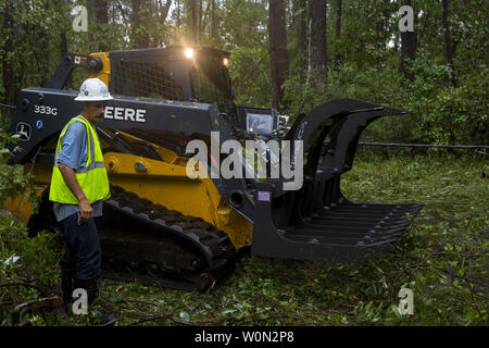 Workers clear debris from Hurricane Florence on Marine Corps Base Camp Lejeune, on September 15, 2018. Hurricane Florence impacted Marine Corps Base Camp Lejeune and MCAS New River with periods of strong winds, heavy rains, flooding of urban and low lying areas, flash floods and coastal storm surges. Photo by Lance Cpl. Isaiah Gomez/U.S. Marine Corps/UPI - Stock Photo