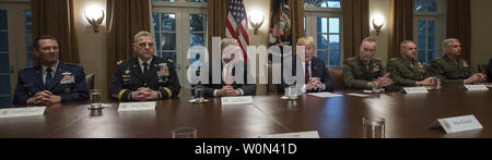 United States President Donald J. Trump makes a statement to the media as he prepares to receive a briefing from senior military leaders in the Cabinet Room of the White House in Washington, DC on Tuesday, October 23, 2018.  The President took questions on the proposed space force, immigration, the caravan and Saudi actions in the killing of Jamal Khashoggi.   From left to right: US Air Force General Joseph L. Lengyel, Chief of the National Guard Bureau; US Army General Mark A. Milley, Chief of Staff of the Army; US Secretary of Defense James Mattis; the President; US Marine Corps General Jose - Stock Photo