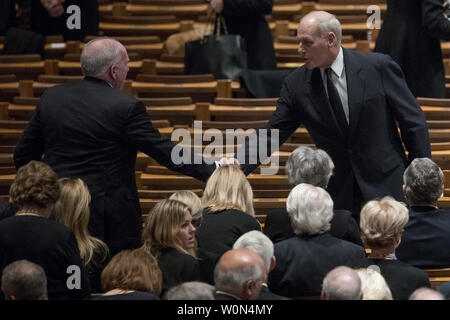 Former CIA Director John Brennan, left, shakes hands with President Donald Trump's Chief of Staff John Kelly, right, before a State Funeral for former President George H.W. Bush at the National Cathedral, Wednesday, Dec. 5, 2018,  in Washington, DC.   Photo by Andrew Harnik/UPI - Stock Photo