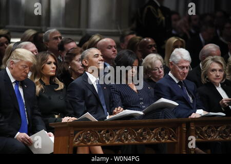 From left, President Donald Trump, first lady Melania Trump, former President Barack Obama, Michelle Obama, and former President Bill Clinton listen during a State Funeral at the National Cathedral, Wednesday, Dec. 5, 2018, in Washington, DC for former President George H.W. Bush.      Photo by Alex Brandon/UPI - Stock Photo