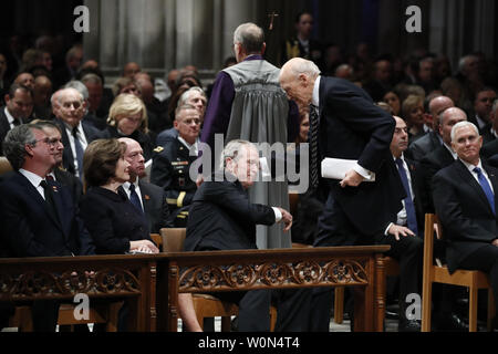 Former President George W. Bush shakes hands with former Sen. Alan Simpson, R-Wyo, after he spoke during the State Funeral for former President George H.W. Bush at the National Cathedral, Wednesday, Dec. 5, 2018, in Washington. Watching are Jeb Bush and Laura Bush. At right is Vice President Mike Pence.       Photo by Alex Brandon/UPI - Stock Photo