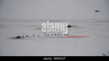 Russian Search and Rescue teams arrive at the Soyuz MS-09 spacecraft shortly after it landed with Expedition 57 crew members Serena Aunon-Chancellor of NASA, Alexander Gerst of ESA (European Space Agency), and Sergey Prokopyev of Roscosmos near the town of Zhezkazgan, Kazakhstan, on December 20, 2018. Aunon-Chancellor, Gerst, and Prokopyev are returning after 197 days in space where they served as members of the Expedition 56 and 57 crews onboard the International Space Station. NASA Photo by Bill Ingalls/UPI - Stock Photo