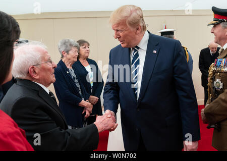 President Donald J. Trump, joined by Britain's Queen Elizabeth II,  meets with World War II veterans and their families during a D-Day National Commemorative Event on June 5, 2019, at the Southsea Common in Portsmouth, England. White House Photo by Andrea Hanks/UPI Stock Photo