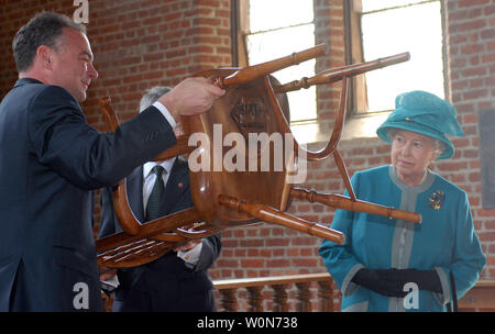 Britain's Queen Elizabeth II looks on as Va. Gov. Tim Kaine shows a carving on chair she gave him and the people Virginia inside the church at Historic Jamestowne, the site of Britain's first settlement in the New World, in Virginia on May 4, 2007.    (UPI Photo/Roger L. Wollenberg) Stock Photo