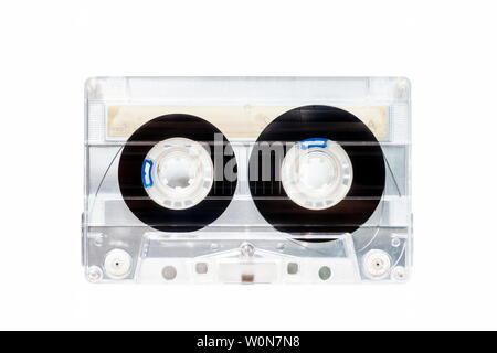 Transparent plastic C90 compact cassette audio tape isoltaed against a white background - Stock Photo