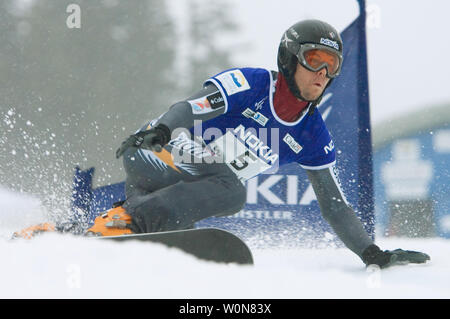 Jasey Jay Anderson of Canada on course to first place place in the men's dual Parallel Giant Slalom event of the FIS Whistler World Snowboard Championships on Blackcomb Mountain, January 18, 2005.    (UPI Photo/Heinz Ruckemann) - Stock Photo
