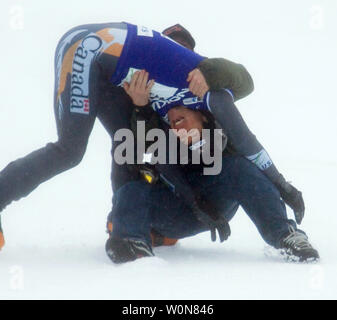 Jasey Jay Anderson of Canada receives a hug from team mate Francois Boivin (silver in Boardcross) after winning the men's dual Parallel Giant Slalom event of the FIS Whistler World Snowboard Championships on Blackcomb Mountain, January 18, 2005.    (UPI Photo/Heinz Ruckemann) - Stock Photo
