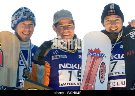 L. to R. Nicolas Huet of France, silver; Jasey Jay Anderson of Canada, gold and Siegfried Grabner of Austria, bronze share the award stand for the men's Parallel Slalom event of the FIS Whistler World Snowboard Championships on Blackcomb Mountain, January 19, 2005.    (UPI Photo/Heinz Ruckemann) - Stock Photo