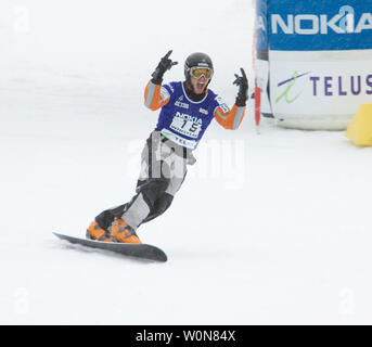 Jasey Jay Anderson of Canada celebrates gold in the men's Parallel Slalom event of the FIS Whistler World Snowboard Championships on Blackcomb Mountain, January 19, 2005. Yesterday Anderson won gold in the men's Parallel Giant Slalom.    (UPI Photo/Heinz Ruckemann) - Stock Photo