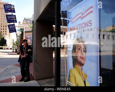A man holds signs showing support for Democratic presidential candidate Sen. Hillary Clinton (D-NY) outside of the Clinton headquarters in Charleston, West Virginia on May 13, 2008. West Virginians head to the polls today as they vote in that states Presidential primaries. (UPI Photo/Kevin Dietsch) - Stock Photo