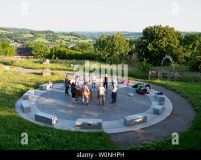 UK Weather news: group of drummers playing and enjoying the end of a sunny warm day at the star disc above Wirksworth in the Derbyshire Dales, Peak District National Park - Stock Photo