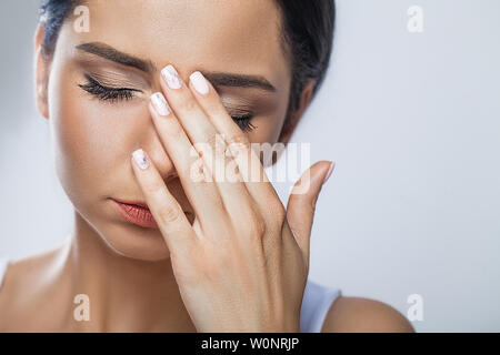 Health And Pain. Stressed Exhausted Young Woman Having Strong Tension Headache. Closeup Portrait Of Beautiful Sick Girl Suffering From Head Migraine - Stock Photo