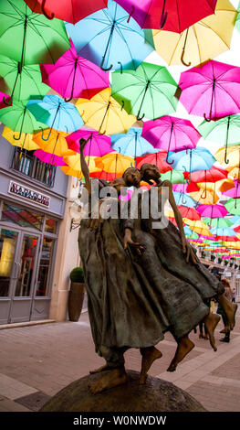 The Umbrella Sky Project by Patricia Cunha and the whimsical sculptures by Dirk De Kayzer delight visitors to Le Village Royal in Paris France - Stock Photo