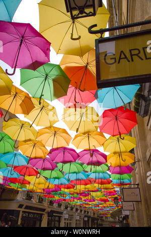 The Umbrella Sky Project by Patricia Cunha deligts visitors to Le Village Royal in Paris France - Stock Photo