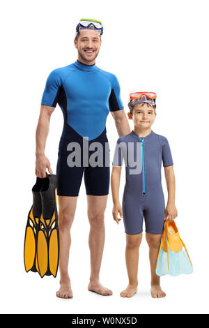 Full length portrait of a child and man in wetsuits standing and holding diving flippers isolated on white background - Stock Photo