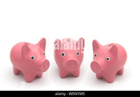 Three pink piggy bank pigs forming a choir on white background