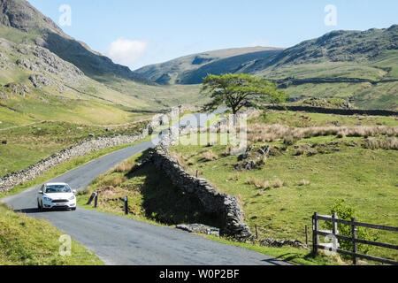 View from A592,road,also known as,aka,The Struggle,up,and over,the Kirkstone Pass,from, Ambleside,to,from,Patterdale.Very steep,road,with,gradient. - Stock Photo