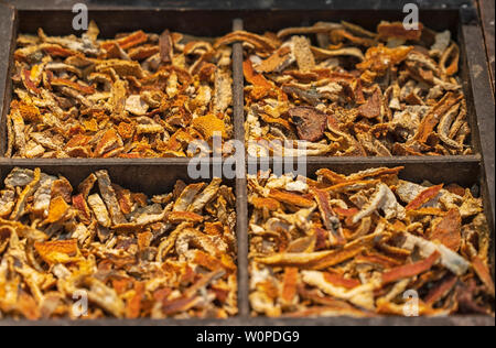 Dried orange peel in a wooden box. - Stock Photo