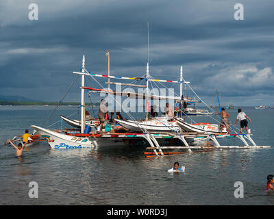 Kiamba, The Philippines - May 31, 2019: Outrigger tuna fishing boat being made ready to leave at the beach in Kiamba, Sarangani Province in the Philip - Stock Photo