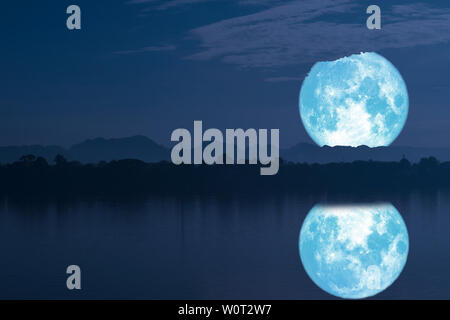 strawberry moon on night sky back silhouette mountain reflection on river, Elements of this image furnished by NASA - Stock Photo