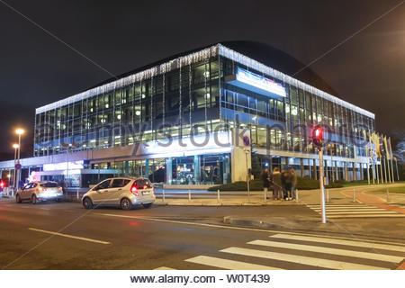 ZAGREB, CROATIA - DECEMBER 13th, 2017: Advent time in city center of Zagreb, Croatia. Illuminated building of Concert Hall of Vatroslav Lisinski during the night. - Stock Photo