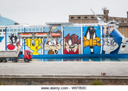 LA SPEZIA, ITALY : JUNE 15th, 2005 : Moby Lines Moby Wonder ferry ship with characters of Looney Tunes drawn at the side of the ship, docked in a port of La Spezia, Italy. - Stock Photo