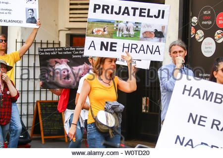 ZAGREB,CROATIA - MAY 19, 2018 : People protesting against animal exploitation in slaughterhouses and holding protest signs in city center in Zagreb, Croatia. - Stock Photo