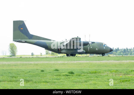 BERLIN - APRIL 26, 2018: Landing of the military transport aircraft Transall C-160D. German Air Force. Exhibition ILA Berlin Air Show 2018. - Stock Photo
